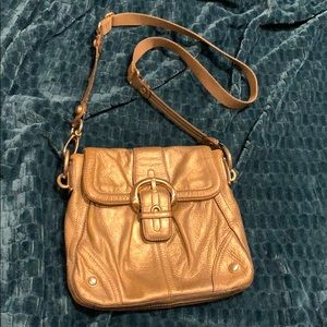 B. Makowsky gold crossbody.